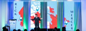 Rick mercer on stage at conference
