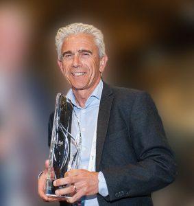 Frank S. Capon Winner image holding trophy